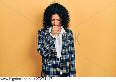 Young latin girl wearing business clothes feeling unwell and coughing as symptom for cold or bronchitis. health care concept.