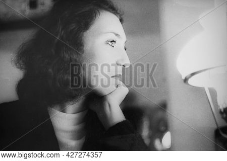 Vintage Black And White Portrait Of A Woman With A Kerasin Lamp, Close-up. Early 1980s. Old Surface,