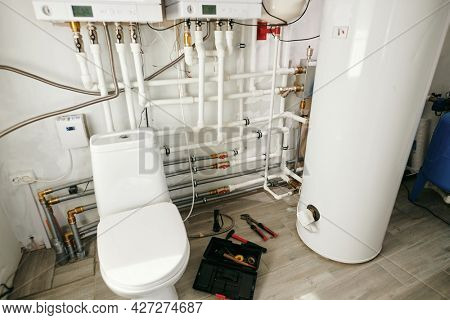 Spacious lavatory with toilet bowl inside large modern house