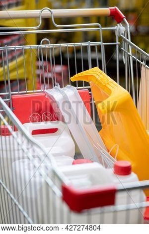 Pile of chosen household goods in shopping cart