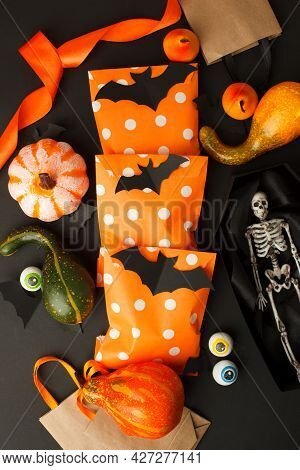 Happy Halloween Holiday Concept. Creative Idea Decoration Of Traditional Candy Bags On Black Backgro