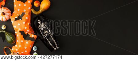 Happy Halloween Holiday Concept. Decorative Skeleton Of Man In Paper Handmade Coffin And Traditional
