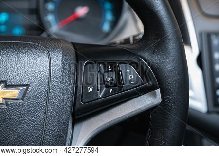 Novosibirsk, Russia - July 07, 2021:   Chevrolet Cruze, Black Steering Wheel With Multifunction Butt