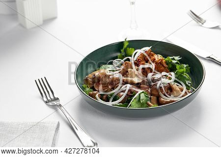 Mushrooms With Onions And Herbs, Assorted Pickled Mushrooms In A Plate On A Light Background, Marina