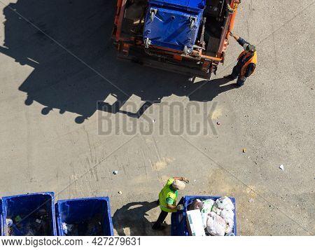 Chelyabinsk,chelyabinsk Oblast, Russia-june 28.2021 Garbage Collection Process Top View. Men In Glov