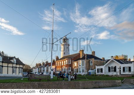 A View Of Southwold Inshore Lighthouse At Sunset On A Cold Autumn Evening