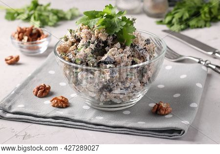 Georgian Salad With Eggplant And Walnuts In A Transparent Bowl On A Light Gray Background. Tradition