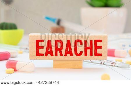 Doctor Shows Information On Blackboard: Earache. Medical Concept.