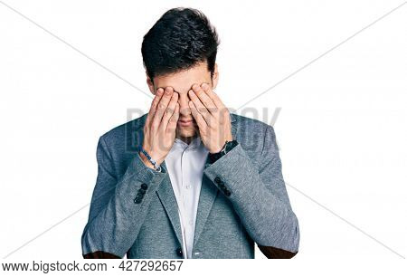 Young hispanic man wearing business clothes rubbing eyes for fatigue and headache, sleepy and tired expression. vision problem