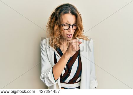 Young caucasian woman wearing business style and glasses feeling unwell and coughing as symptom for cold or bronchitis. health care concept.