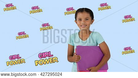 Composition of text girl power over girl with notebooks. girl power, positive female strength and independence concept digitally generated image.