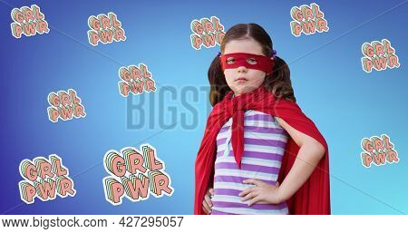 Composition of text girl power over girl in superhero costume. girl power, positive female strength and independence concept digitally generated image.