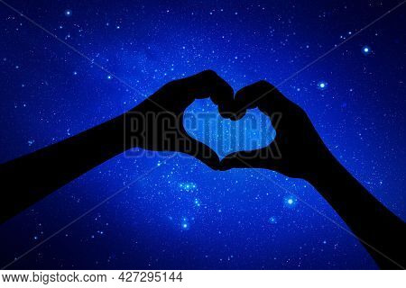 Bird Shaped Hands. Hand Gesture Silhouette. Starry Sky And Milky Way