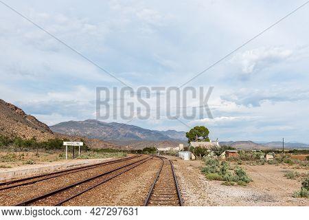 Vondeling Railway Station On Road R407 Between Klaarstroom And Willowmore. Railway Tracks Are Visibl
