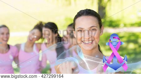 Composition of pink breast cancer ribbon over group of smiling women. breast cancer positive awareness campaign concept digitally generated image.