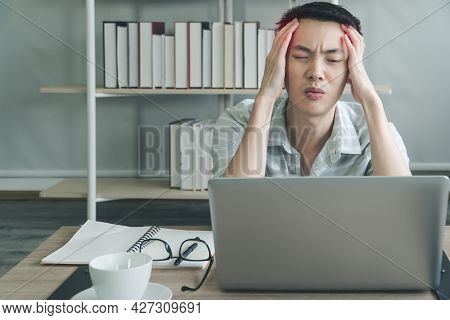 Freelance Young Man Working On Laptop And Having A Headache, Tired, At Home Office. Businessman Vide