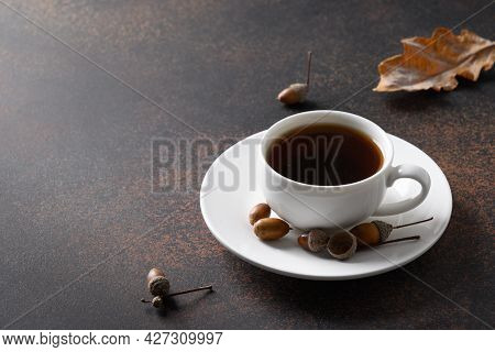 Acorn Coffee In Cup On Brown. Coffee Substitute Without Caffeine.