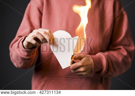Woman Sets The Heart On Fire, The End Of The Romantic Relationship. Young Girl Sets Fire To A White