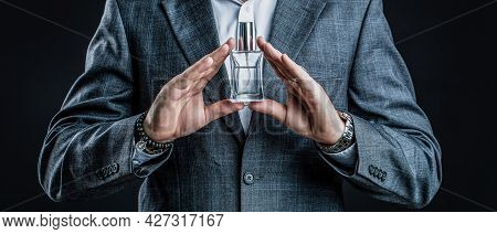 Masculine Perfume, Bearded Man In A Suit. Male Holding Up Bottle Of Perfume. Man Perfume, Fragrance.