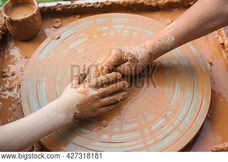 Teacher And Kid Making Ceramic Pot. Potters And Child Hands. Pottery Workshop Outside. Master Teachi