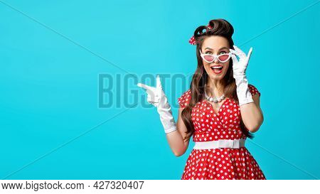 Omg, Cool Offer. Excited Young Pinup Lady Pointing At Free Space Over Blue Studio Background, Banner