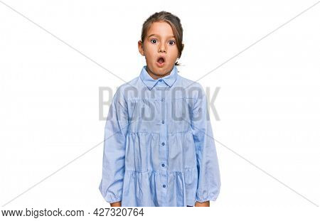 Little beautiful girl wearing casual clothes scared and amazed with open mouth for surprise, disbelief face