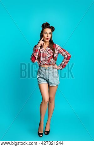 Surprised Pinup Woman In Retro Style Clothes Cannot Believe Great Offer Or Huge Sale Over Blue Studi