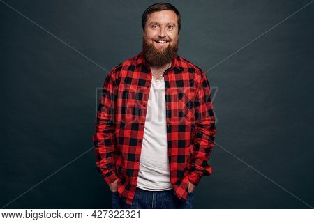 Good-looking Stylish Modern Hipster Guy With Stylish Haircut, Beard, Wear Red Checkered Shirt, Hold