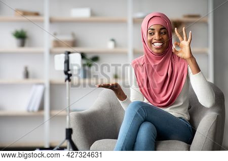 Happy Black Muslim Blogger Lady In Hijab Capturing Video Review At Camera