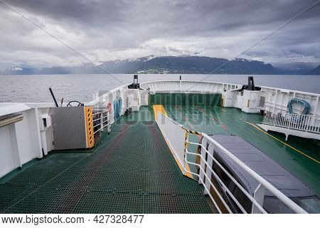 Deck Of A Ferry Sailing Across Norwegian Fjord On A Cloudy And Rainy Day With Mountains In The Haze