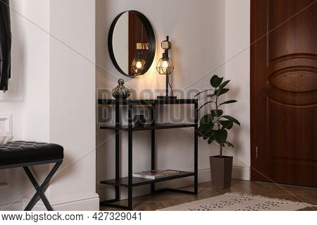 Console Table With Decor And Mirror On White Wall In Hallway. Interior Design