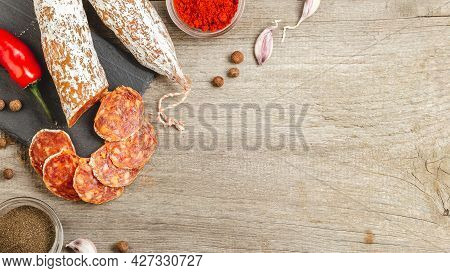 Sliced Chorizo Sausage With Penicillium Edible Mold On The Outside On A Wooden Background With Smoke