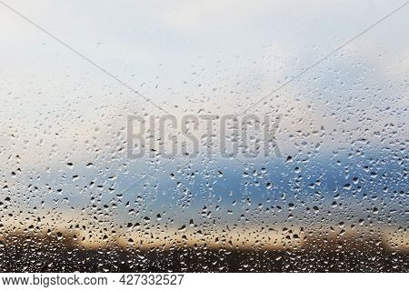 Glass Background With Raindrops On A Sunset Background