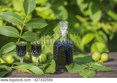 Liqueur From Young Green Walnuts, Remedy For Stomach Ache, Close Up. Tincture Of Green Walnuts In A