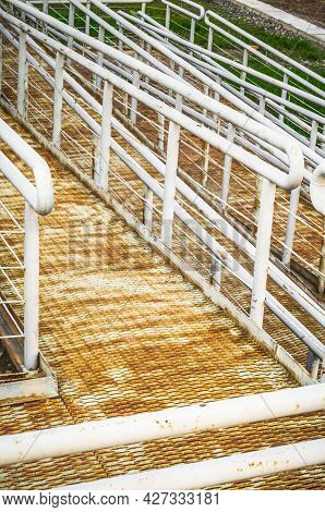Rusty Metal Ramp And Stairs For Wheelchairs In A City