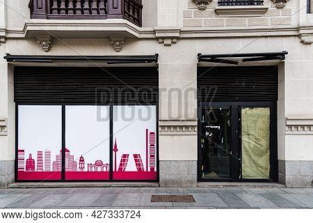 Madrid, Spain - March 7, 2021: Empty Closed Storefront In Serrano Street. The Coronavirus Pandemic H