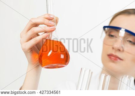 High Tech Chemical Industry Concept With Female Scientist. Young Woman Laboratory Technician In Prot