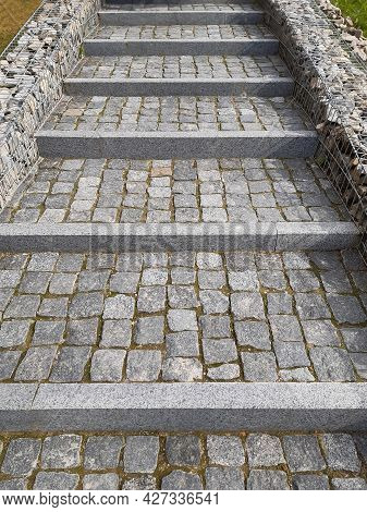 Sidewalk Steps Of Tiled Stone Lined With Rows, Leaving In Perspective With Borders Decorated With Bo