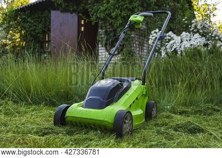 Lawn Mower On The Grass, Lawn Care, Mowing The Grass, Country Cares, Lawn Mowing With An Electric La