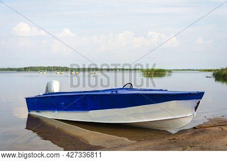 Aluminum Blue Fishing Boat With A Motor Near The Lake Shore, Fishing, Tourism, Active Recreation, Li