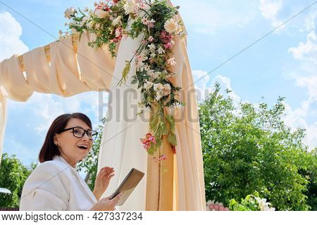 Decorating Arch With Textiles With Flowers And Plants. Woman Organizer, Owner, With Digital Tablet N