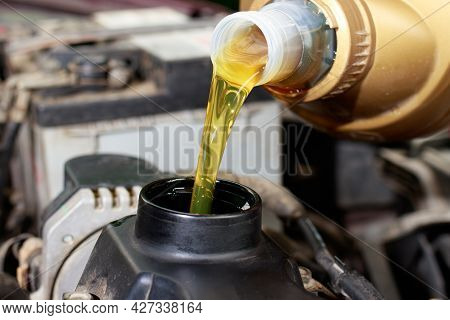 The Car Maintenance Master Pours Engine Oil For The Car Engine. Car Care, Engine Cleanliness, Car Se