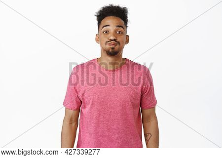 Funny African American Man With Afro Hair And Moustache, Making Silly Pouting Face And Smiling, Grim