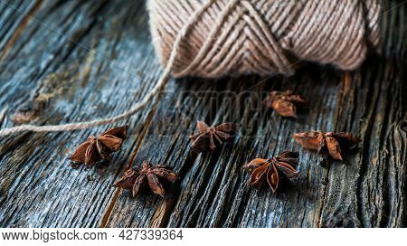 Anise on rustic wooden background macro