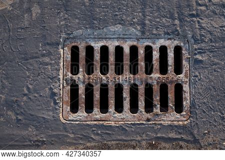 Concrete Metal Drainage Grate. Rusty Sewer Grill