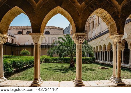 Cefalu,sicily-june 6, 2021.roman Catholic Cathedral With Cloister,arcade Has Pointed Arches And Colu