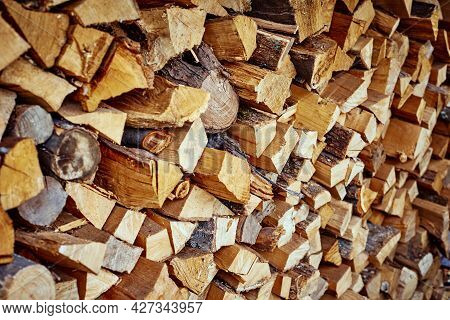 Stack Of Firewood As Background. Pile Of Chopped Wood, Close Up