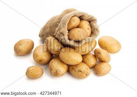 New Potatoes In Burlap Sack Isolated On White Background. Raw Potato