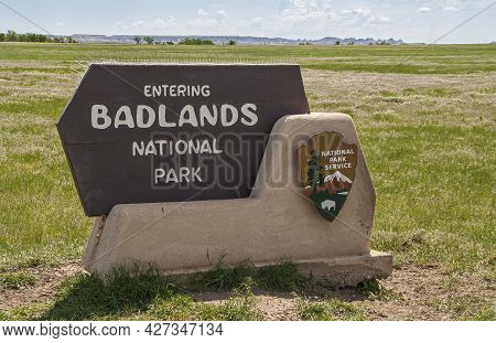 Badlands National Park, Sd, Usa - June 1, 2008: Closeup Of White On Brown Sign Announcing The Name O