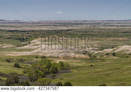 Badlands National Park, Sd, Usa - June 1, 2008: Wide Landscape Of Green Prairie With White And Beige